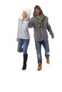 Happy couple hand in hand at wintertime smiling Royalty Free Stock Photo
