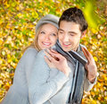 Happy couple have a romance in fall branches of wood Royalty Free Stock Photography