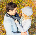 Happy couple have a romance in the orest fall forest Stock Photo