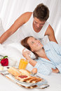 Happy couple having breakfast Royalty Free Stock Images