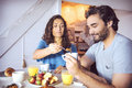 Happy couple having breakfast together Stock Photography