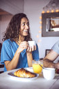 Happy couple having breakfast together Stock Photo