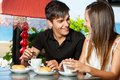 Happy couple having coffe together close up portrait of teen enjoying breakfast in restaurant Stock Photo