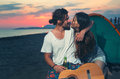 Happy couple having fun on the beach in sunset Royalty Free Stock Photo