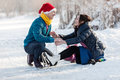 Happy couple having fun ice skating on rink outdoors Royalty Free Stock Photo