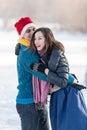Happy couple having fun ice skating on rink outdoors. Royalty Free Stock Photo