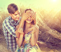Happy couple having fun outdoors on wheat field Royalty Free Stock Photo