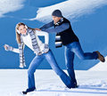 Happy couple having fun in snow running jumping catching fight game playing outdoors at winter snowy mountains people at nature Royalty Free Stock Photo