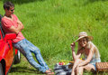 Happy couple having picnic together on a sunny day Royalty Free Stock Photos