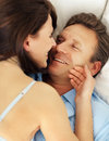 Happy couple having a seductive moment in bed Stock Photography