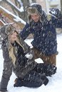 Happy couple having winter fun young loving at in snowfall Stock Photos