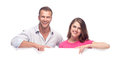Happy couple holding a blank billboard Royalty Free Stock Photos
