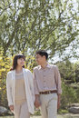 Happy couple holding hands and going for a walk in the park in springtime beijing Royalty Free Stock Photography