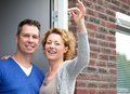 Happy couple holding keys to their new home close up portrait of a Stock Photography