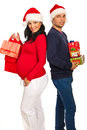 Happy couple holding Xmas gifts Royalty Free Stock Photography