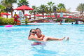 Happy couple on holidays in tropical swimming pool Stock Photography