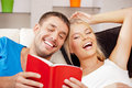 Happy couple at home bright picture of with book Royalty Free Stock Photography