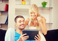 Happy couple at home bright picture of with tablet pc focus on man Royalty Free Stock Photos
