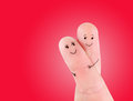 Happy couple hug concept painted at fingers against red background Royalty Free Stock Image