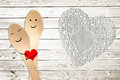 Happy couple hug concept, smiley painted on spoons Royalty Free Stock Photo