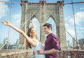 Happy couple hugging each other on the famous brooklyn bridge