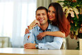Happy couple hugging at home portrait of a young Stock Photography