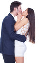 Happy couple hugging and kissing over white background Royalty Free Stock Image