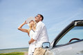 Happy couple hugging near cabriolet car at sea Royalty Free Stock Photo