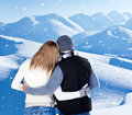 Happy couple hugging outdoor at winter mountains Stock Photos