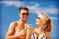 Happy couple with ice cream Royalty Free Stock Photo