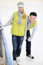 Happy couple in the ice rink Royalty Free Stock Photo