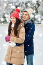 Happy couple ice skating on rink outdoors Royalty Free Stock Photo