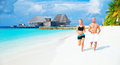 Happy couple jogging on the beach white sandy luxury maldives resort workout outdoors healthy lifestyle active summer time Royalty Free Stock Photos