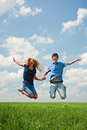 Happy couple jumping Stock Photos