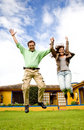 Happy couple jumping of joy Royalty Free Stock Image