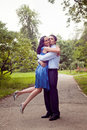 Happy couple in a kiss and hug moment Royalty Free Stock Image