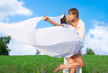 Happy couple kiss of in love on sky background Royalty Free Stock Photography