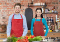 Happy couple in kitchen at cooking class Royalty Free Stock Photo