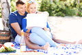 Happy couple with laptop at the beach Royalty Free Stock Photo