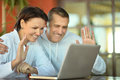 Happy couple with laptop Royalty Free Stock Photo