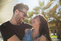 Happy couple laughing together standing outside Royalty Free Stock Photo