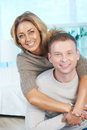 Happy couple looking at camera with smiles Stock Photography