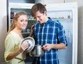 Happy couple looking food near fridge Royalty Free Stock Photo