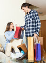 Happy couple looking their purchases in home Royalty Free Stock Photography