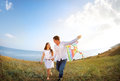 Happy couple in love with flying a kite on the beach Royalty Free Stock Photo