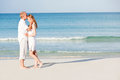 Happy couple in love having fun on the beach Royalty Free Stock Photo