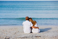 Happy couple in love having fun on the beach Royalty Free Stock Photography