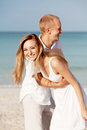 Happy couple in love having fun on the beach Royalty Free Stock Image