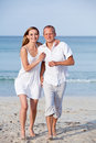 Happy couple in love having fun on the beach Royalty Free Stock Photos