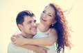 Happy couple in love laughing hugging Royalty Free Stock Photography